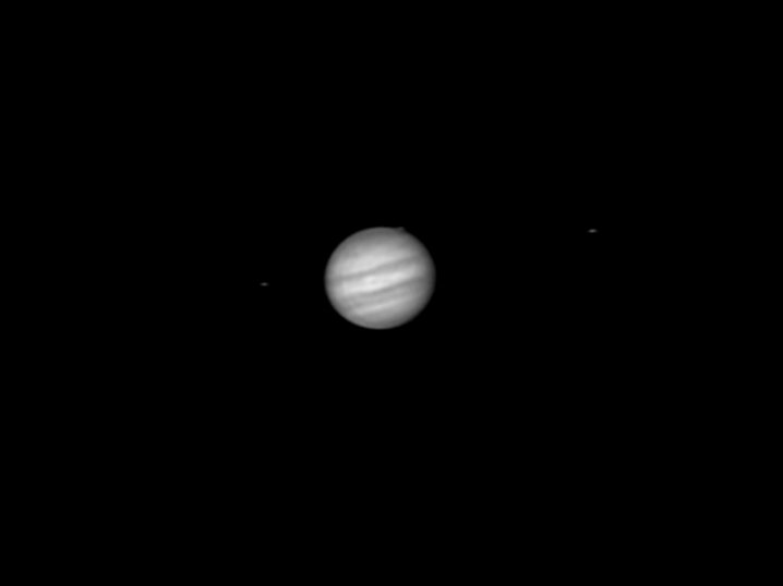 From left to right: Europa, Jupiter, Ganymede, Io.