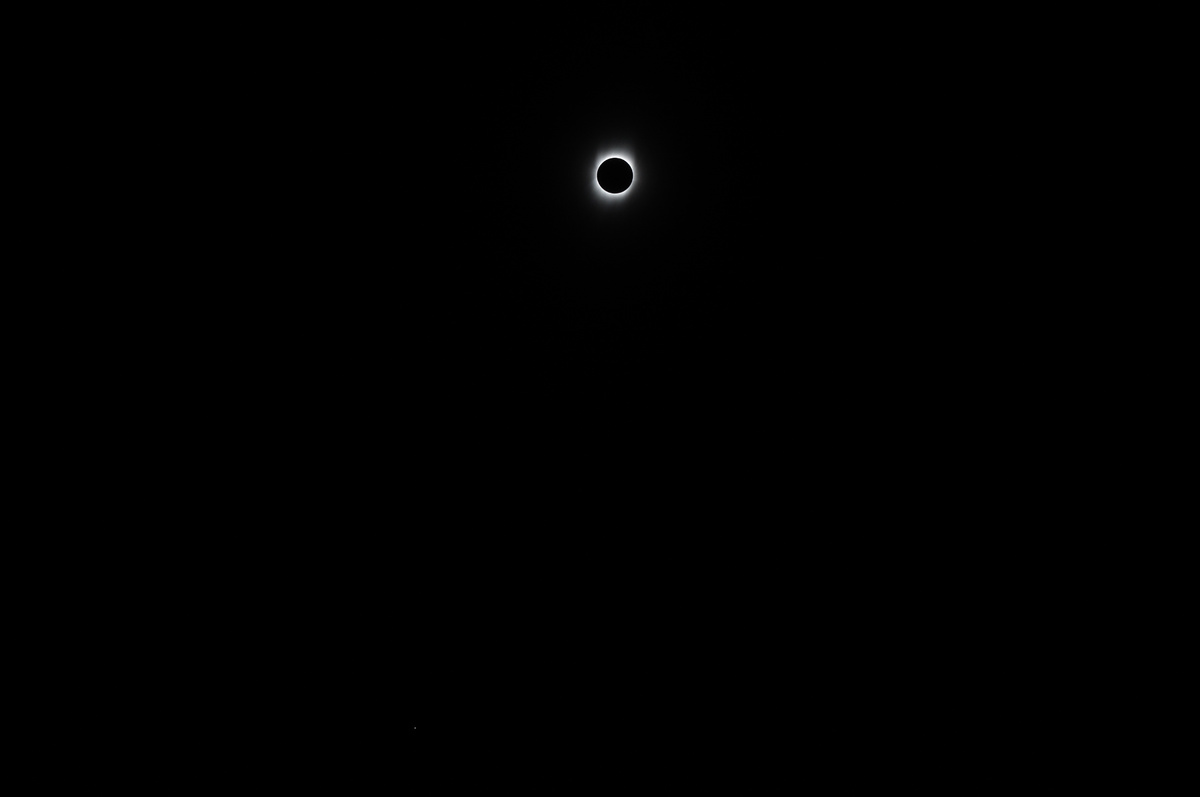 Totality and Mercury (bottom left) My cousin Bill's photo taken with Nikon D90 and Nikkor AF-S VR 70-300mm lens. ISO 200, f/5.6, 1/100s