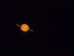 saturn 0002: Saturn and Titan through my Celestron GP-C8, Meade TeleXtender 2x, with SPC900. Approx 1000 frames at 10fps, Sunday, May 23, at 23:30 CET