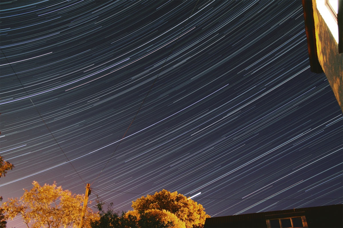Startrails, 240 x 30 Second (2 Hours) exposures combined, Canon 50D + EFS18-55 Lens @ 18mm FL - ISO800. 30th August, 2010. Jupiter is the bright trail starting just over the middle tree at the bottom of the image.