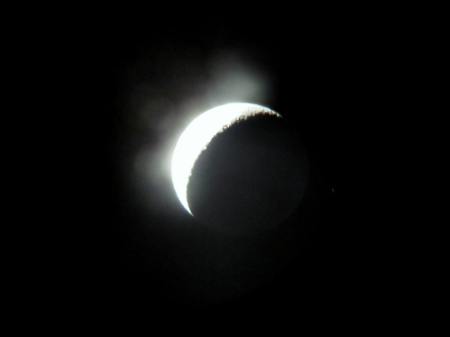"""The waxing crescent moon showing a glimpse of """"earth shine"""" and the star HIP 107820:"""
