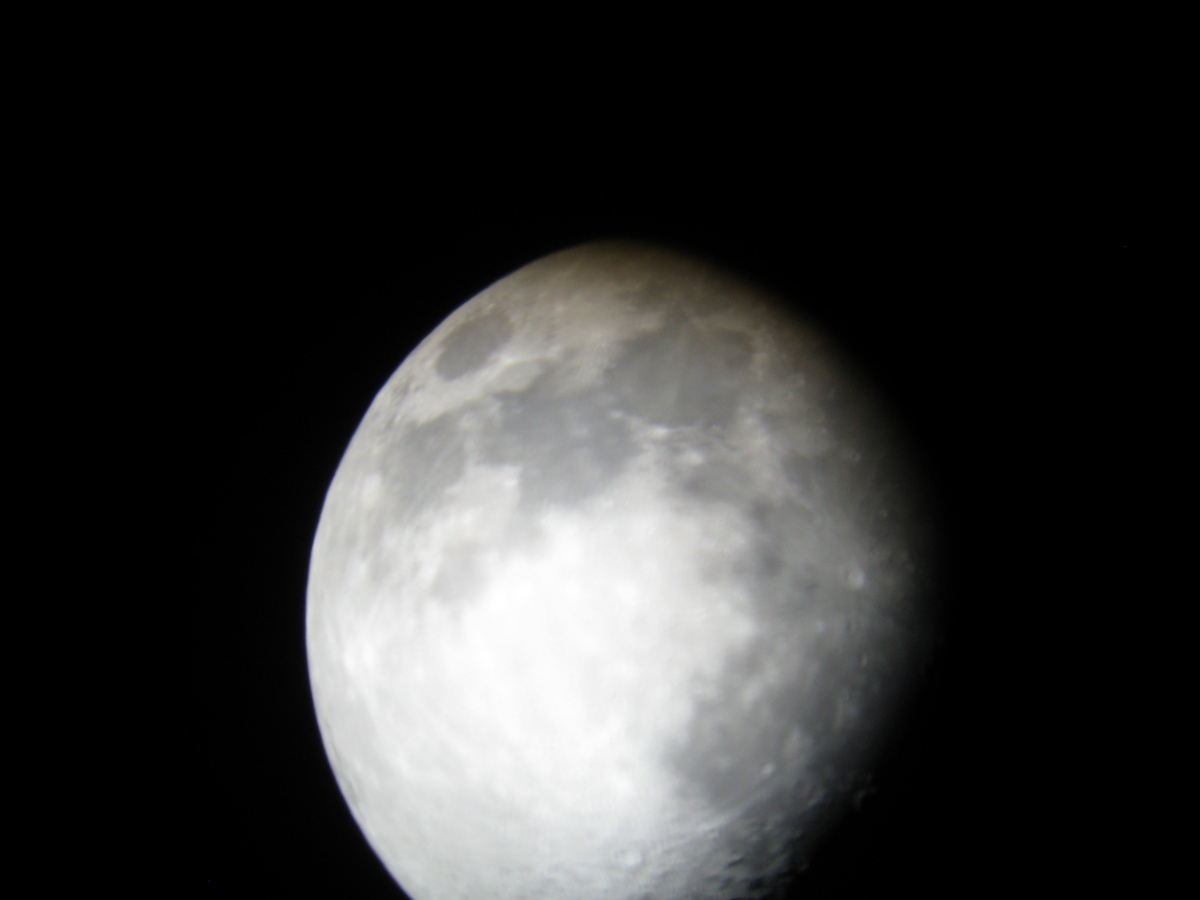 1st moon image through 25mm eyepiece taken with a point and shoot.