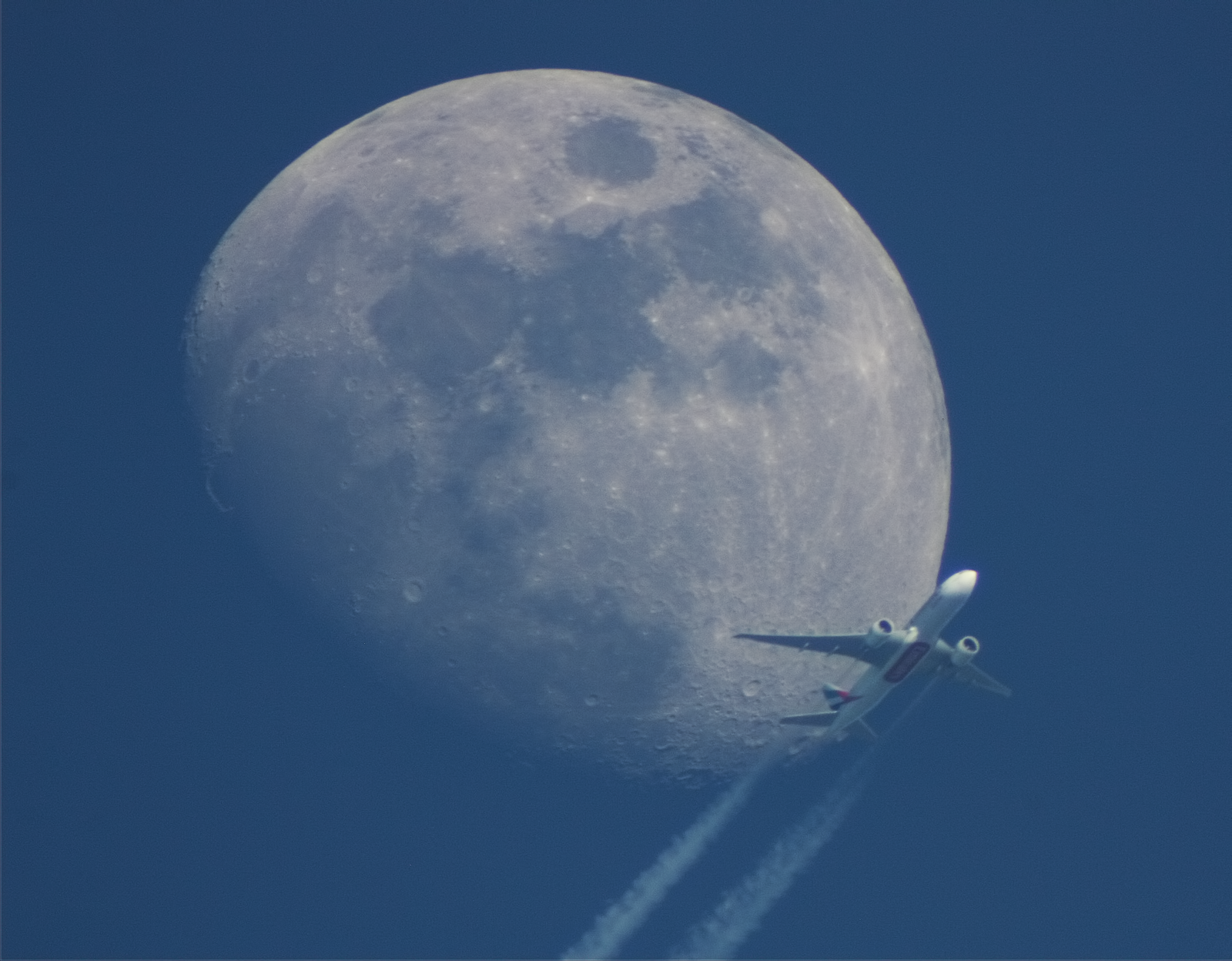 Moon with plane