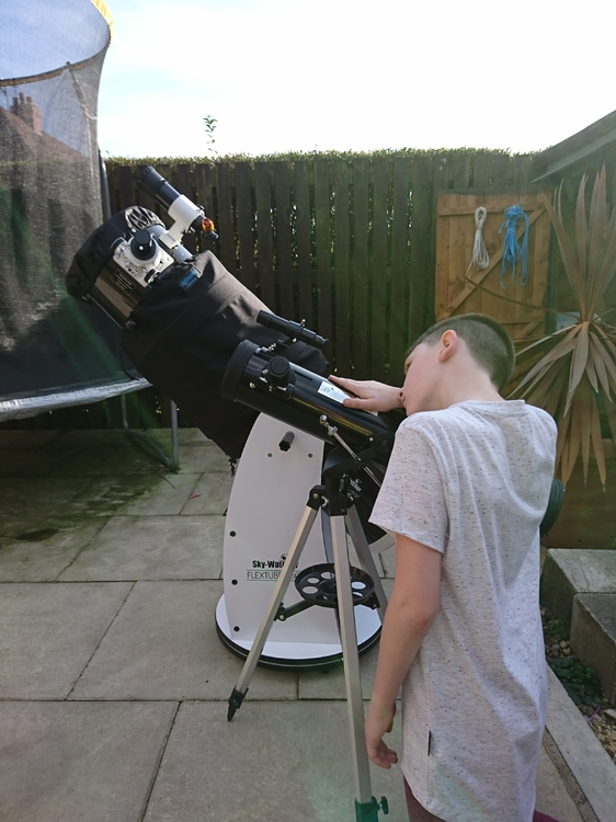 My son and his starter scope next to my shiny new dob